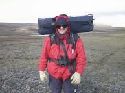 Bo Landin carrying the tri pod and camera equipment on Tundra Expedition -99 (Canadian Nunavut)